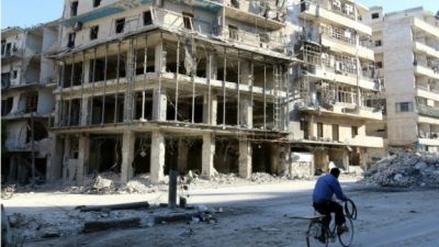 161020114906_a_man_rides_a_bicycle_near_damaged_buildings_in_the_rebel_held_besieged_al-sukkari_neighbourhood_of_aleppo_640x360_reuter_nocredit.jpg